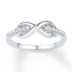 A line of sparkling round diamonds flows through an infinity symbol in this trendy mid-finger ring for her. Styled in sterling silver, the ring has a total diamond weight of carat. Diamond Total Carat Weight may range from - carats. Mid Finger Rings, Natural Blue Diamond, Ring Set, Rings For Her, Fashion Rings, Diamond Engagement Rings, Fine Jewelry, Jewelry Rings, Jewellery