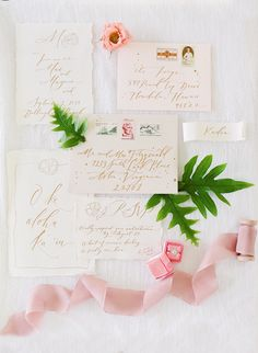 tropical pink and gold wedding stationery