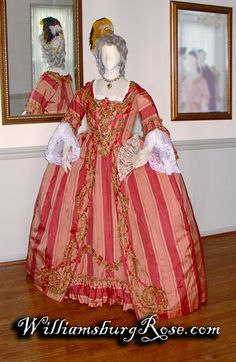 #49_ 1760s_coral stripe silk moire ball gown; robings, stomacher, sleeves flounces and petticoat front heavily decorated with fly fringe, silk flowers and silk ribbon. By Williamsburg Rose