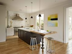This kitchen acts a social hub within the home where the family can come together and guests can be entertained.   www.woodstockfurniture.co.uk
