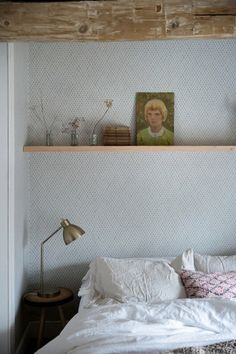 10 Spots to Sneak in a Little More Shelf Storage | Apartment Therapy / long shelf above the bed