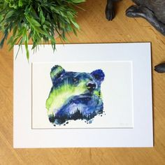 Double Exposure Watercolour // Aurora Bearealis - Limited Edition  The northern lights were once called The Dance of the Spirits, and it is not hard to see why. Here they dance inside a North American bear...  //  This is a limited edition mounted print of only 15 of the original painting Aurora Bearealis by the artist Robert James Hull.  Out of the 15 of these prints, there are only 5 that come with mounts.  This item is a giclée print measuring 9 x 12 (23cm x 30cm). Incl...