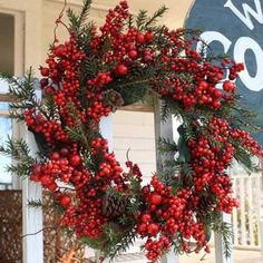 Full Wreath with Cedar Stems, Leaves, Assorted Sized Red Berries and Pine Cones - Beautiful 22 Inch Weather Resistant Wreath that can be used Indoors or Outdoors - Sturdy Built Wreath on Grapevine Bas