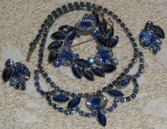 So cool. Why  did they overkill w/ brooch & necklace ?I would make brooch into bracelet ALady VINTAGE JULIANA D&E REVERSE CARVED PEACOCK BLUE AB RHINESTONE DEMI PARURE SET #Unbranded