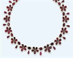An early 19th century gold and garnet necklace. A single row of foiled garnet graduated flowerhead panels to chain-link connections, each with garnet two stone drop intervals to a matching clasp, circa 1820.