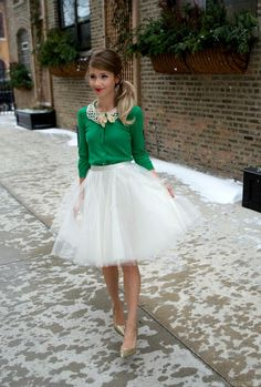 Shop this look on Lookastic:  http://lookastic.com/women/looks/pumps-clutch-full-skirt-cardigan-necklace/6920  — Gold Sequin Pumps  — Gold Sequin Clutch  — White Tulle Full Skirt  — Green Cardigan  — Beige Necklace