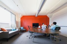 Making a workspace fun and comfortable with company colors and upgraded basics worked wonders for a San Francisco startup. Even their company pug agrees.