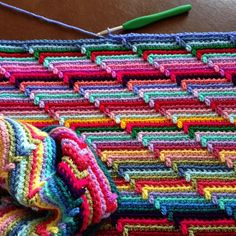 Simple stripes with a spike into the second row down, but the visual impact is great! Going to do this with all that left over yarn!