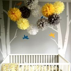 Not too girly. love it!! poms to decorate Hang from ceiling instead of mobile