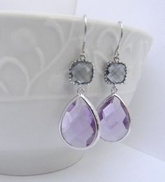 Lavender and Gray Earrings - Purple and Gray Earrings - Bridesmaid Earrings - Dangle Earrings - Bridesmaid Gift - Gift Idea For Her  These Earrings are just gorgeous. The lavender and gray create an ombre affect. These earrings are the perfect size and would make great bridesmaid earrings. Perfect for trending spring and summer wedding colors.  The lavender glass gems are 18mm by 22 mm and are rhodium plated. The gray square glass blocks are 9mm with 3mm thickness. The earwires are rhodium…