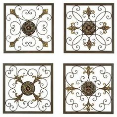 4-piece metal wall plaque set with scrollwork detailing and fleur-de-lis accents.