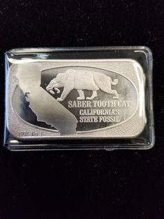 VINTAGE 1974 USSC SABERTOOTH CAT CALIFORNIA'S STATE FOSSIL SILVER ART BAR 1 OZ