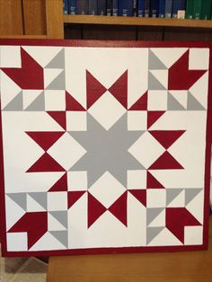 Red, grey and white barn quilt