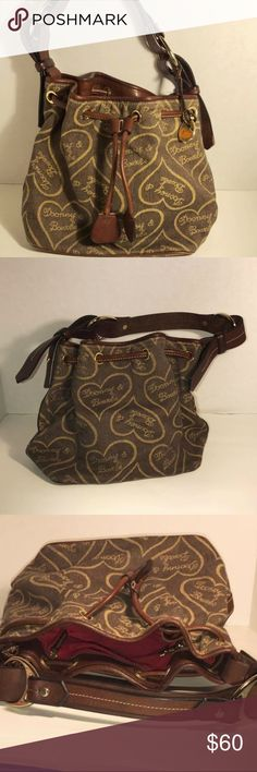 """(Dooney & Bourke) Drawstring Bucket Purse Bag tote Dooney & Bourke  Approximate Measurements   10"""" 10"""" 6.25""""  Drop 8.5""""  Inside has some marks/spots  Outside Excellent Thank You!!! NOTE:   I list for friends as well so items may come from a home with pets or smokers. POLICY:  We strive for a 5 Star rating, if we fail in this task we are happy to accept returns for any discrepancies on our part.   I travel and will get back to you and ship asap sku2164bluewgwtub Dooney & Bourke Bags Shoulder…"""