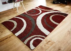 Impressive and modern geometric patterns with bold and striking colour theme, this Aura Shaggy Rug is a wonderful addition to your décor. #shaggyrugs #geometricrugs #modernrugs #redrugs