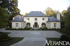 stone-like color of stucco with the steely gray of the slate 'French Style Manse'