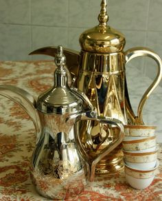 ARABIC COFFEE, dalllahs. An authentic dallah (coffee pot) on the left and a themos flask on the right.