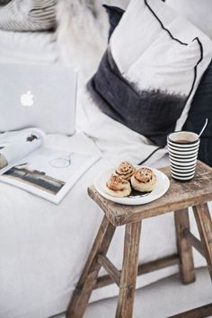 Breakfast in bed tastes better when you have a gorgeous wood stool to set it on.