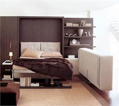 The Atoll 202 Space Saving System consists of a Queen wall bed (modern Murphy Bed) attached to 42 inches of shelving with a sofa and an . Diy Murphy Bed, Modern Murphy Beds, Murphy Bed Plans, Space Saving Bedroom, Space Saving Furniture, Murphy-bett Ikea, Canapé Angle Convertible, Resource Furniture, Canapé Design