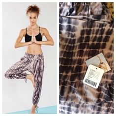 Urban Outfitters Onzie Wanderer Gypsy Yoga Pants Urban Outfitters Without Walls Loose Wanderer/Gypsy yoga pant from Onzie in their signature Free Flow Fabric that's breathable, durable, and quick-drying. Soft waistband can be worn high or folded over and voluminous design allows full range of motion for any kind of practice. Cutout detail with tie at ankles. Perfect for hot yoga but also suited to other types of workouts. Can even be worn in chlorinated pools or salt water.  Onzie is created…