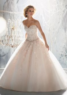 A true ball gown for a true beauty! This is Mori Lee 1970 wedding dress and wearing it will make you feel like Cinderella on the day she married the Prince. Absolutely stunning with raised embroidery and gorgeous beading, the wedding dress shows passion and purpose for an unforgettable day. #timelesstreasure