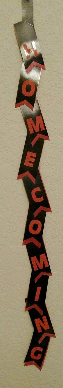 Black and orange homecoming mum ribbon. Designed by Crafty bug