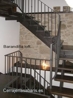 Barandill a loft..... construida en hierro y acabado en negro forja