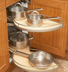 Doesn't seem to give you a lot of shelf space, though...    Kitchen Cabinet Blind Corner Pull Out