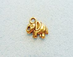 10 gold elephant charms  hollow backed   antique gold by trcharms