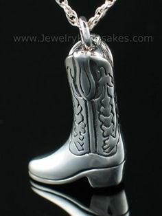"""Jewelry Keepsakes, Great Falls, Montana 59401, 1-877-723-7229 (US Customers Toll Free) The whimsical sterling silver boot urn keepsake is a wonderful tribute to your loved one. This high quality urn pendant will hold a small amount of cremains in remembrance of your loved one. A threaded stopper assures you that your loved ones cremains are protected inside your keepsake urn pendant. Size: 5/8"""" w x 1-1/4"""" h Loved doing business with Jewelry Keepsakes! Only took 3 days with engraving."""