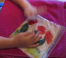 wool felting in a ziploc bag! fun & easy for all ages: get your wool roving in the design you want, put it in the ziploc bag with soapy water, seal well, smoosh and pound and work away at it!
