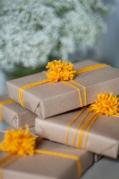 Contrasting pompoms/wrapping yarn dress up these packages nicely.