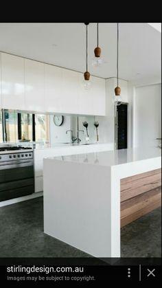Kitchen island, mirror splash back, polished concrete floor, bifold door
