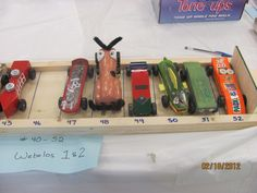 Pinewood Derby. Great idea to help keep up with the cars.