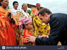 France's President Nicolas Sarkozy (R) meets people