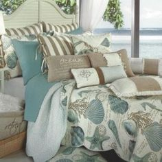 blue and white shell bedding set on the bed complete with mocha pillows. Pleasing Idea Of Beach Theme Bedding Make You Being Cozy Beach Theme Bedding, Coastal Bedding, Luxury Bedding, Beach Bedding Sets, Nautical Bedding, Tropical Bedrooms, Coastal Bedrooms, Coastal Living Rooms, Tropical Bedding