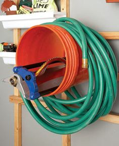 Storing hoses and cords on thin hooks or nails can cause them to crack or lose their shape. Five-gallon buckets fitted with a scrap of 3/4-in. plywood in the bottom and then screwed to the wall make great multipurpose holders. The plywood can be any shape, but to give it a more finished look, cut a circle slightly smaller than the diameter of the bucket. Stash the sprinkler head inside.
