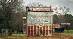 An old Dr. Pepper ad painted onto the side of an abandoned tobacco barn in North Carolina. This was popular advertising in the old south. The barn owner would receive a crate of cola every year as payment. I miss the simplicity...