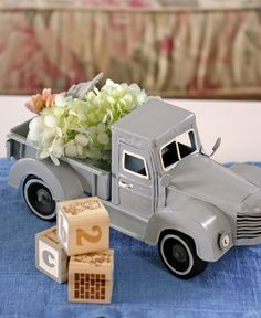 want an old toy truck like this. Would be cute for both the baby shower and then his room!I want an old toy truck like this. Would be cute for both the baby shower and then his room! Baby Shower Flowers, Baby Shower Table, Shower Party, Baby Shower Parties, Baby Shower Themes, Baby Boy Shower, Baby Shower Gifts, Shower Ideas, Baby Showers