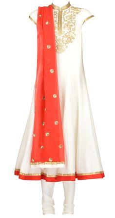 Amrita Thakur's Ivory cotton silk panelled kurta with faresha embroidery on kurta. It comes with a red pure chiffon dupatta with a cotton silk churidaar. Shop at https://www.perniaspopupshop.com/whats-new/amrita-thakur-4