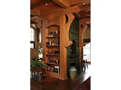 Andie MacDowell's tudor style fairy tale home. . .adjacent to kitchen book case and fire place