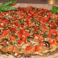 ULTIMATE RAW PIZZA - THE CRUST 3 Large Yellow Onions  2/3 Cup Flax Seeds, ground (I used Brown, but Golden will also work)  1/2 Cup Sunflower Seeds, ground  1/4 Cup Almond Flour, (dehydrated almond pulp)  1/3 Cup Nama Shoyu  1/4 Cup Olive Oil (cold pressed or non-pressed)  2 Tbs Nutritional Yeast  1 Tbs Oregano  1 Clove Garlic, minced  1 Tsp Himalayan Crystal Salt (more or less to taste)    Equipment Needed:    Coffee Grinder  Food Processor  Dehydrator with non-stick sheets