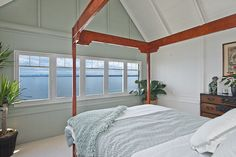 Rockaway Beach Cottage Master Bedroom - Lay in bed and watch the city lights and ferry go by.