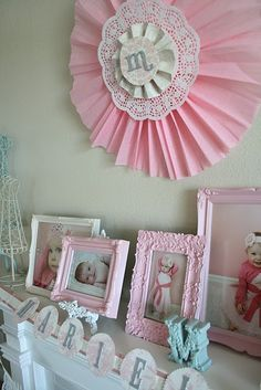Loving the pink vintage looking frames with babies pictures from the first year.