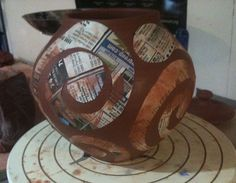Paper stencils and wax resist on pottery (Nancy Gallagher Pottery)
