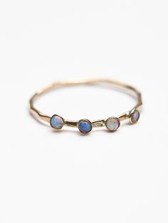 Crown Opal Delicate Ring | Textured gold or rose gold delicate band featuring four opal stones.  American made.