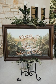 DIY welcome sign - thrift store painting project - Creative Midwest Wedding at Silver Oaks Chateau - The Rowlands Photography and Filmmaking - St. Louis Wedding Photographers - St. Louis Engagement Photographers