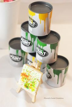 Mini plastic paint cans with puzzles inside // perfect Art Party favors