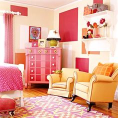 Oversize furniture adds a touch of whimsy to this bright orange and hot pink room.