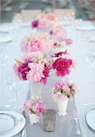 gray runner + pink and fucshia flowers in milk glass vases